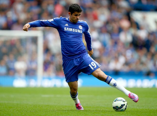 Diego Costa kicking the ball towards the target
