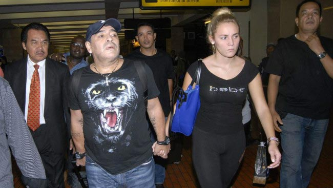 Diego Maradona with girlfriend Rocio Oliva at Buenos Aires airport in 2012