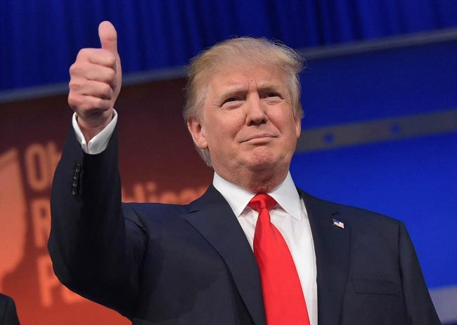 Donald Trump thumbs up sign public meeting supporters February 2015