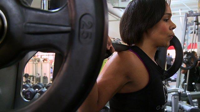 Eve Guzman doing squats
