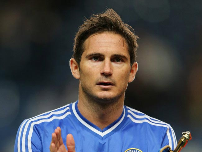 Frank Lampard applauds Chelsea fans during an EPL match at the Stamford Bridge