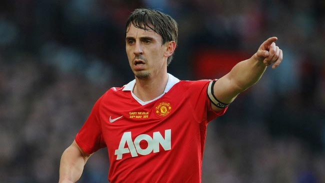 Gary Neville directs his Manchester United teammates while captaining his side in Premier League game in May 2011