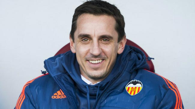 Gary Neville watches on from the home dugout while managing Spanish side Valencia FC in 2015