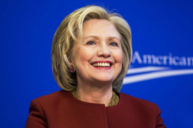 Hillary Clinton smiles attending public event 2015