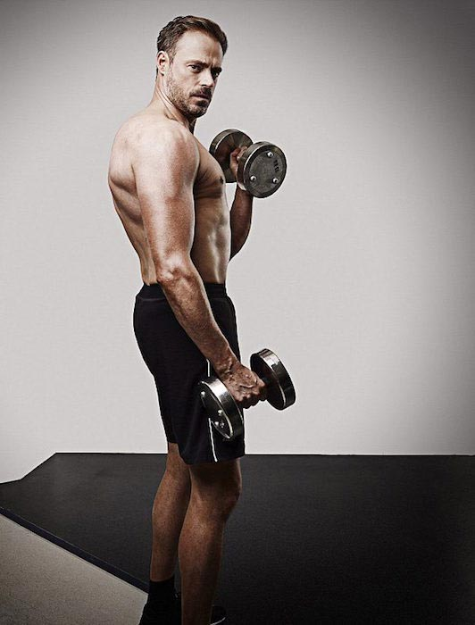 Jamie Theakston doing bicep curls