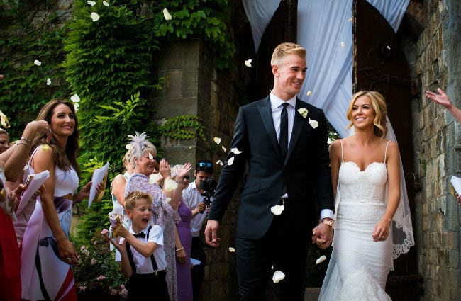 Joe Hart and his wife Kimberly Crew pictured leaving their wedding venue in Florence