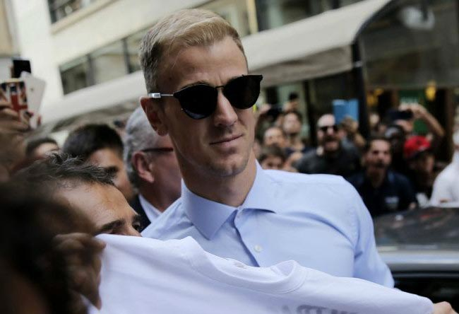 Joe Hart poses with fans while arriving in Turin to complete his transfer to Torino