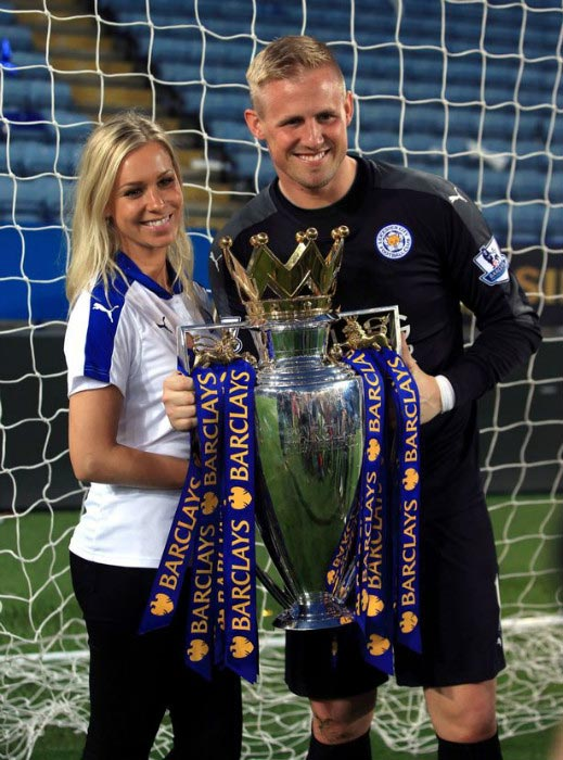 Kasper Schmeichel with his wife Stine Gyldenbrand with the Premier League trophy after home match against Everton on May 2, 2016