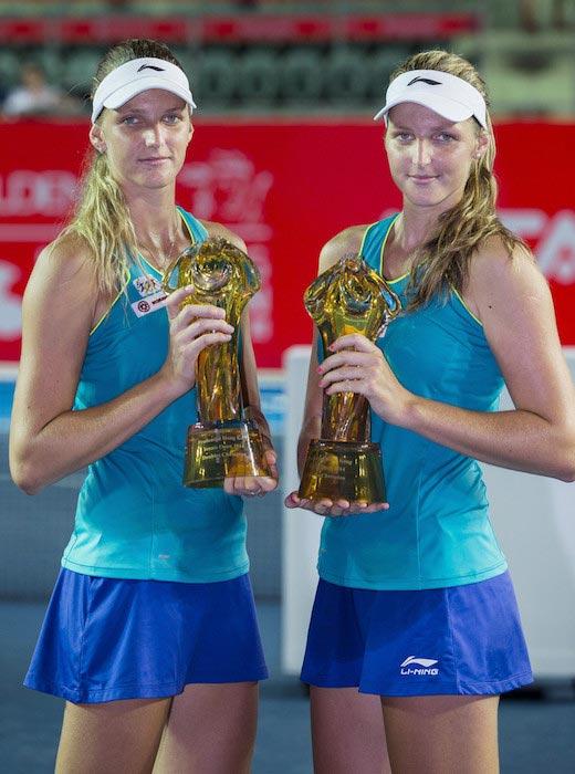 Kristyna Pliskova and Karolina Pliskova trophies winning Hong Kong Tennis Open against Patricia Mayr-Achleitner and Arina Rodionova on September 14, 2014