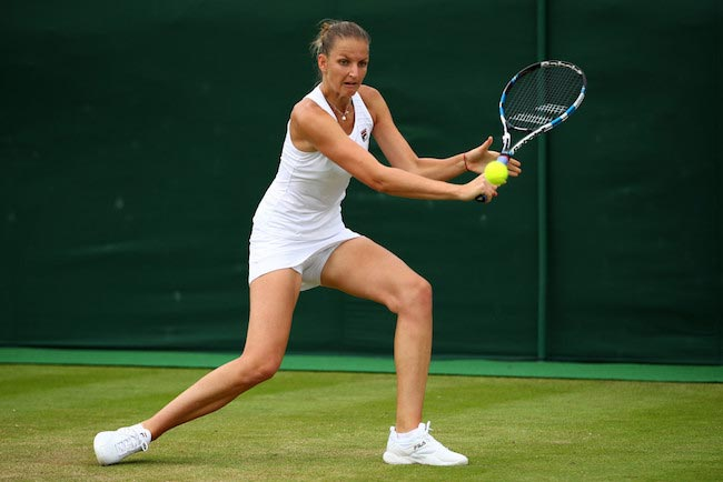 Kristyna Pliskova plays backhand during a match against Misaki Doi of Japan on day 4 of the Wimbledon Tennis Championships on June 30, 2016