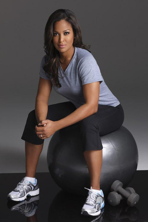 Laila Ali with exercise ball and dumbbells