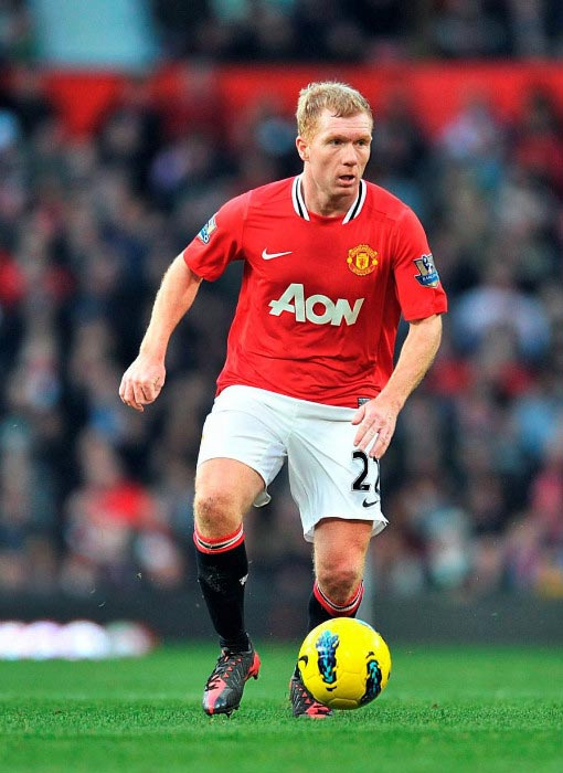Paul Scholes in action for Manchester United during Premier League match at Old Trafford in 2011