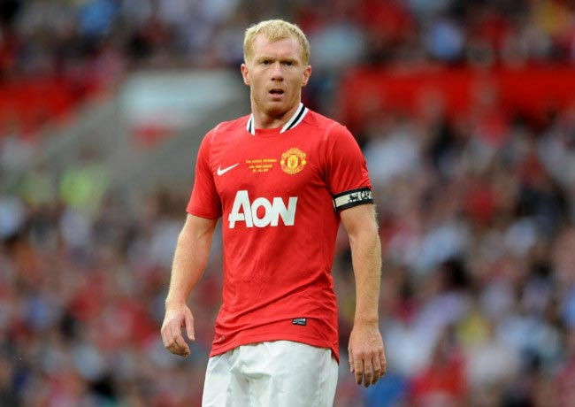 Paul Scholes watches on during his testimonial match held at Old Trafford between Manchester United and New York Cosmos on August 5, 2011