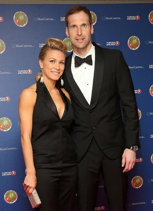 Petr Cech and his wife Martina Cechova pose on red carpet at the Didier Drogba Foundation charity in April 2015