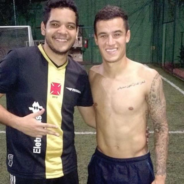 Philippe Coutinho posing shirtless