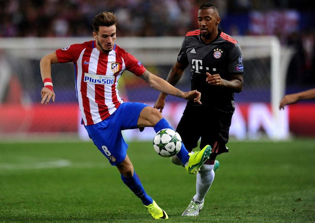 Saul Niguez in duel with Jerome Boateng of Bayern Munich during a Champions League match between Atletico Madrid and Bayern Munich on September 28, 2016