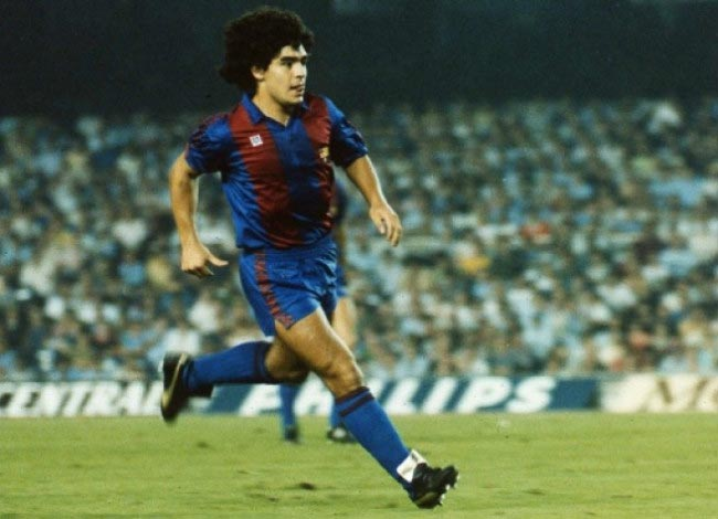 Young Diego Maradona takes a shot in a La Liga match for Barcelona in 1983