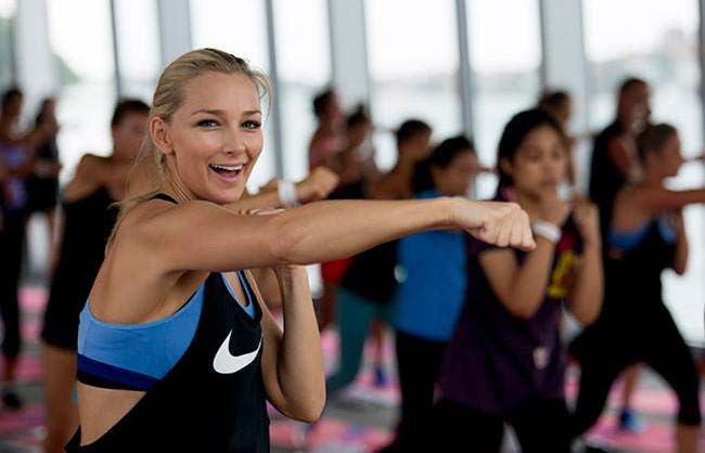 Anna Heinrich working out during a class