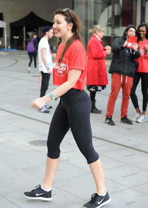 Daisy Lowe in tight leggings for a support cause