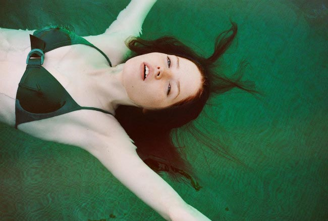 Ellie Bamber in emerald green bikini during an i-D Magazine photoshoot by photographer Angelo Pennetta in April 2015