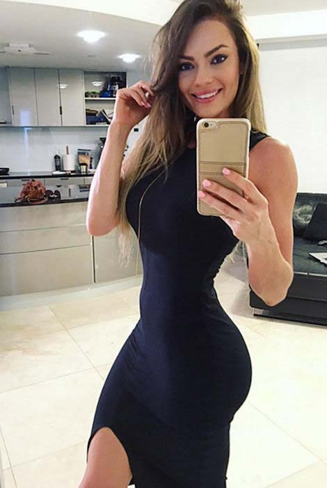 Emily Skye in tight black dress