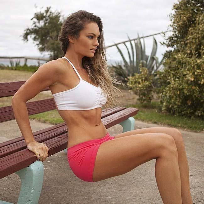 Fitness model Emily Skye doing dips