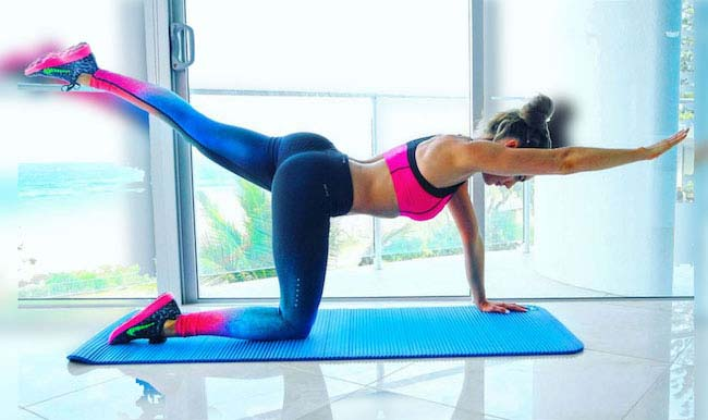 Fitness model Emily Skye doing floor exercises