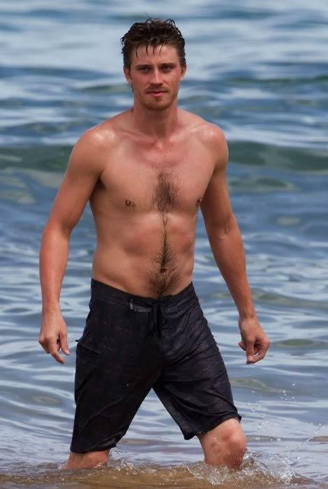 Garrett Hedlund shirtless body at the beach in 2014