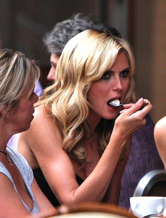 Heidi Klum eating food