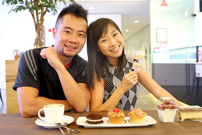 Jaime Teo and Daniel Ong with delicacies