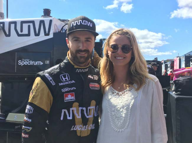 James Hinchcliffe with Rebecca Dalton at a racing event in 2015