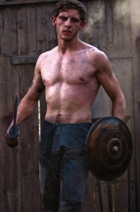 Jamie Bell shows off his toned muscles in shirtless body in a still taken from action movie, The Eagle released in 2011