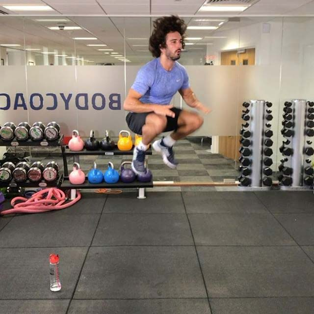 Joe Wicks working out in his gym in November 2016