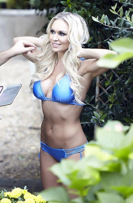 Kristina Rihanoff wears a blue bikini for a Bikini Calendar Shoot in August 2015