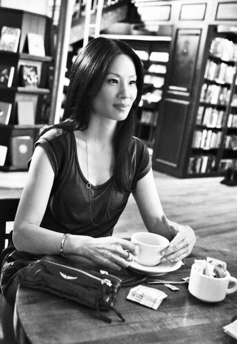 Lucy Liu having coffee