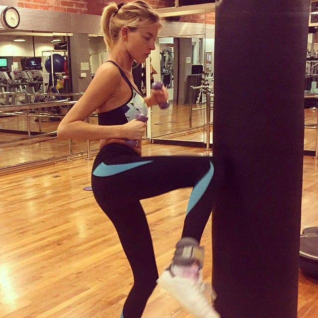 Martha Hunt kickboxing in the gym