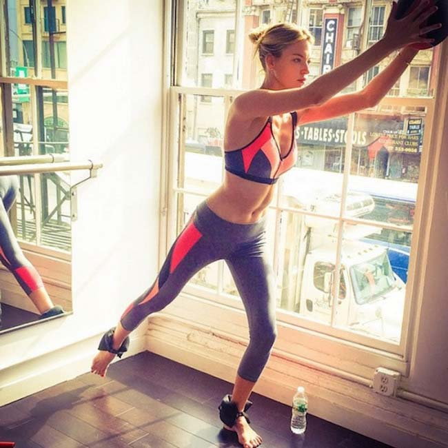 Martha Hunt working out with exercise ball and foot weights