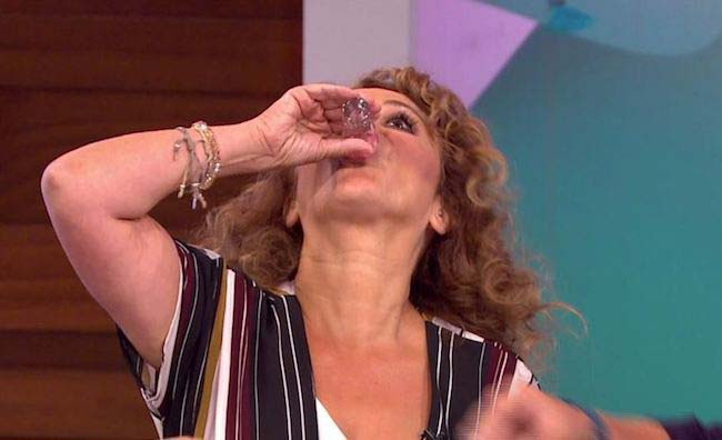 Nadia Sawalha having shots