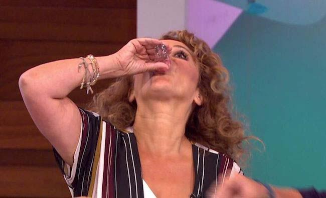 Nadia Sawalha having shots