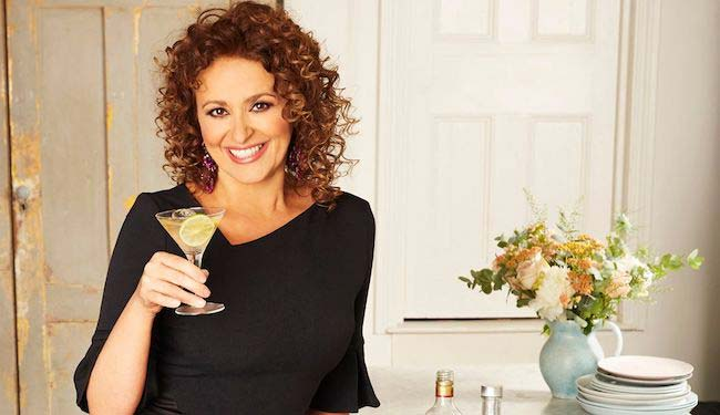 Nadia Sawalha with a drink