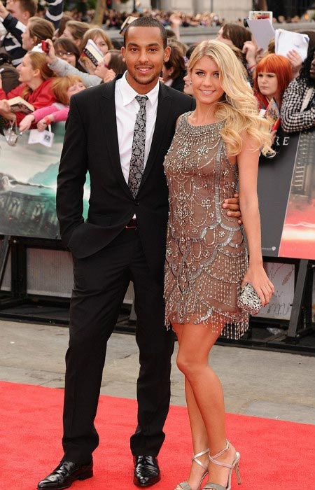 Theo Walcott with Melanie Slade on red carpet at an event held in London in 2015