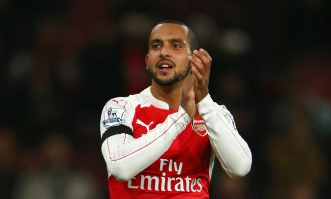 Theo Walcott applauds fans after Arsenal's 2-0 win against Bournemouth at Emirates Stadium in December 2015