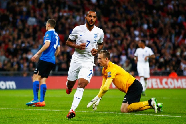 Theo Walcott celebrates after scoring a goal against Estonia at Wembley on October 9, 2015