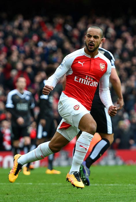 Theo Walcott wheels off in celebration after scoring a goal against Leicester City in February 2016