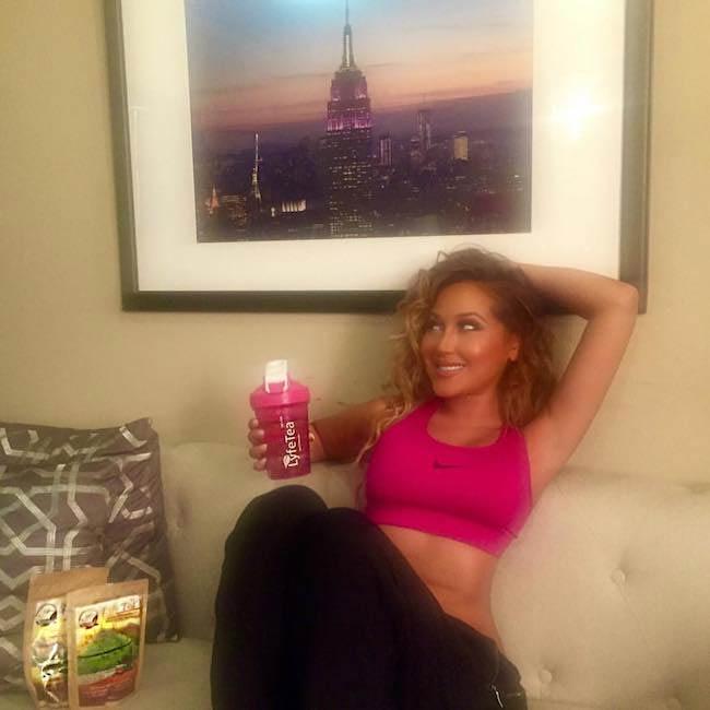 Adrienne Bailon with detox tea