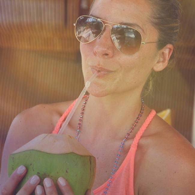 Amanda Byram drinking coconut water