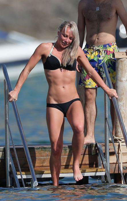 Chloe Madeley in black bikini on a beach in Ibiza in 2016