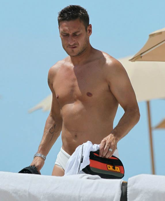 Francesco Totti shirtless relaxes on the beach during summer of 2012