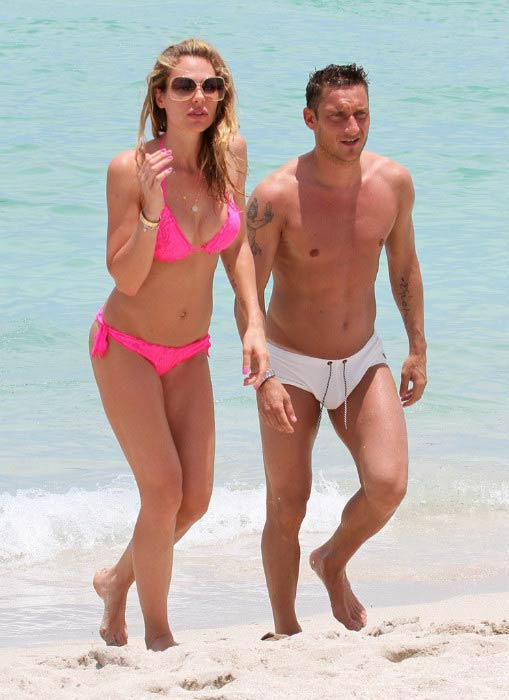Francesco Totti and wife Ilary Blasi on the Miami beach, Florida on June 7, 2012