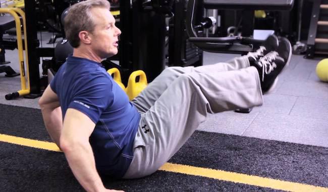 Gunnar Peterson doing leg raise for core